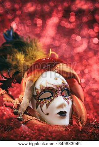Carnival Mask Female Theatrical Face Against Red Bokeh Background. Festive Party Celebration