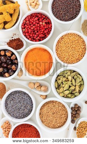 Spices And Herbs Flat Lay, White Background, Top View.