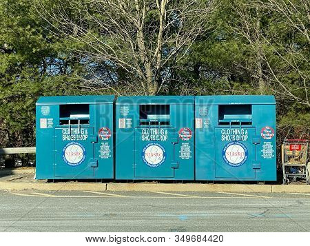 Woodbridge, New Jersey / United States - January 9, 2020: Three Clothing And Shoes Donation Bins Loc