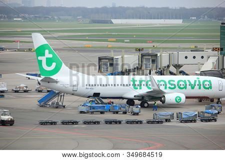 Amsterdam Airport Schiphol  The Netherlands -  April 14th 2018: Ph-hxi Transavia Boeing 737-800 At T