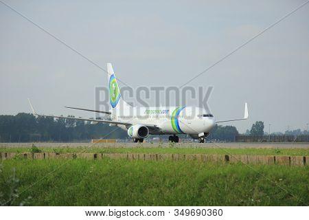 Amsterdam, The Netherlands -  August, 10th 2015: Ph-hsj Transavia Boeing 737-8k2 Taxing After Landin