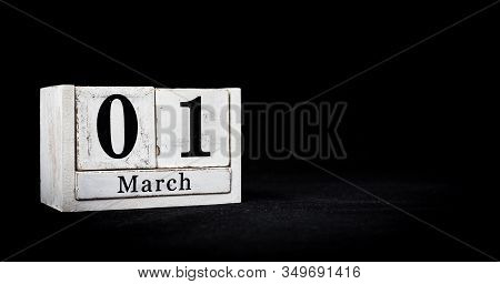 March 1st, First Of March, Day 1 Of Month March - White Calendar Blocks On Black Textured Background