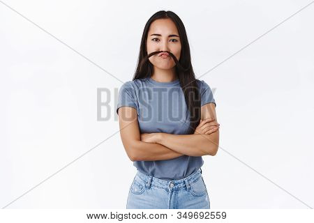 Cute Silly Asian Girl Fooling Around, Mimicking Funny Faces, Cross Hands Over Chest Like Boss Making