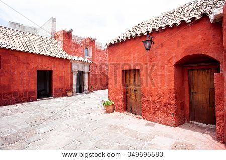 Courtyard In The Monastery Of Santa Catalina, Arequipa, Peru, Along The Walls In Potted Flowers