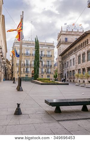 Valencia, Spain - November 3, 2019: Manises Square Adorned With Flags With The Buildings Of The Hote