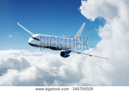 Airplane in the sky flying above the clouds at sunny day