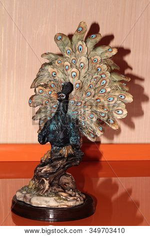 Statuette Of A Peacock Made Of Plaster. Statuette