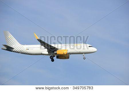 Amsterdam, The Netherlands - July 21st 2016:ec-mle   Vueling  Airbus A320, Approaching Polderbaan Ru