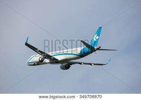Amsterdam, The Netherlands  -  June 2nd, 2017: I-adju Air Dolomiti Embraer Erj-195lr Taking Off From