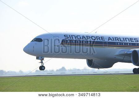 Amsterdam The Netherlands - April 2nd, 2017: 9v-smi Singapore Airlines Airbus A350-900 Takeoff From