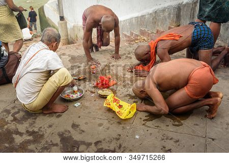 Kolkata, India - March 12, 2019: Indian People Perform Hindu Religious Rituals Near Hooghly Or Ganga