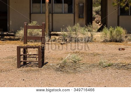 Abandoned, Destroyed Buildings At 6 Road. Old, Damaged Chair In Front Of The House. Ghost Town, Inyo