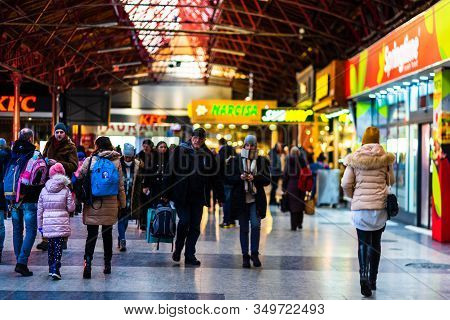 Travelers And Commuters On Their Way To The Train Platform At Bucharest North Railway Station (gara