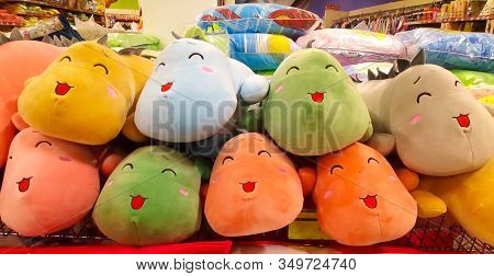Toy Store. Plush Toys On Shelves In The Store For Sale With Prices. Soft Plush Toys For Children Sit