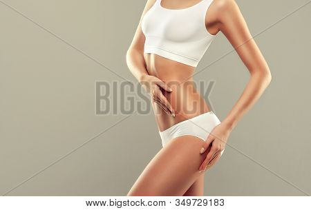 Perfect Slim Toned Young Body Of The Girl . An Example Of Sports , Fitness Or Plastic Surgery And Ae