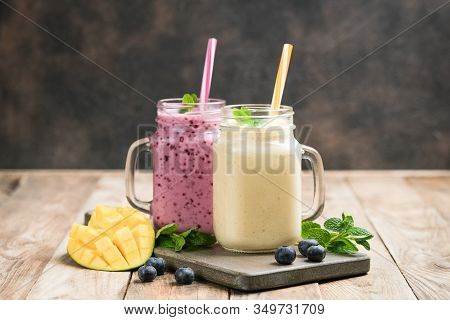 Delicious Blueberry And Mango Smoothie In Mason Jar On A Rustic Background. Healthy Food, Detox Diet