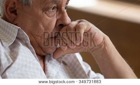 Sad Elderly Male Look In Distance Mourning