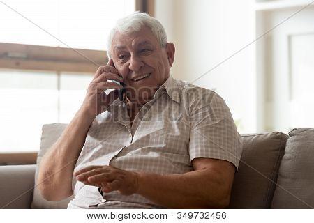 Happy Elderly Man Talk Using Modern Smartphone Gadget