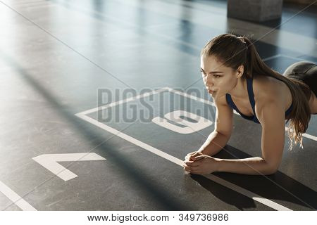 Endurance, Sport And Healthy Lifestyle Concept. Side-shot Focused Young Athletic Woman, Standing In