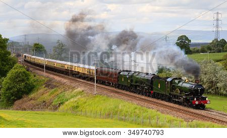 Hackthorpe, England - June 15: Preserved Steam Locomotives 5043 Earl Of Mount Edgcumbe And 46233 Duc