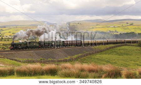 Tebay, England - June 15:  Preserved Steam Locomotives 5043 Earl Of Mount Edgcumbe And 46233 Duchess
