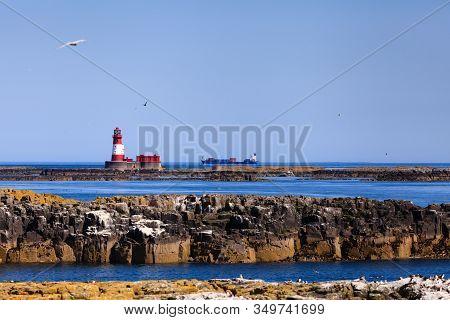 The Farne Islands, England - July 15:  A Ship Sails Past The Longstone Lighthouse On July 15, 2013.