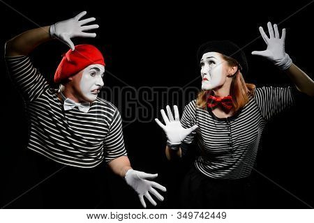 Mimes Hit Invisible Wall. Funny Tricks And Exaggerated Imitation