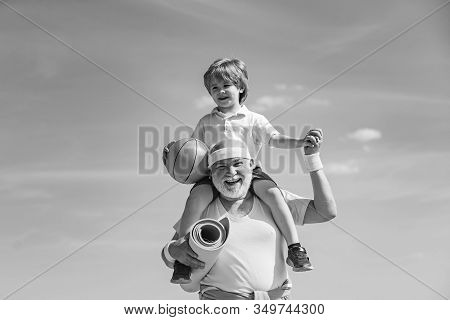 Grandpa And Grandson Spotting. Father And Child Training Together. I Love Sport. Active Family Enjoy