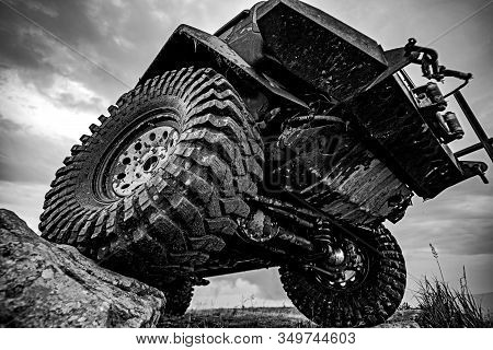 Car Tires Concept On Off Road. Shock Absorber. Travel And Racing Concept For 4x4 Drive Off Road Vehi