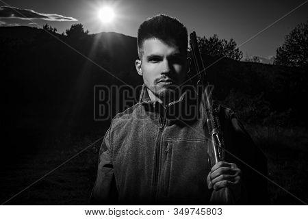 Hunting Gear - Hunting Supplies And Equipment. Hunter With Shotgun Gun On Hunt. Illegal Hunting Poac