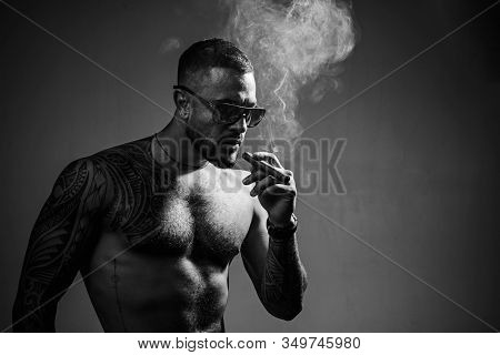 Tattooed Man With Cigar. Cigar Smoking Enjoy Life And Moment. Portrait Of A Bearded Businessman With