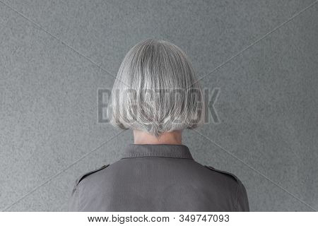 Mature Woman With Natural Gray Hair, From Behind.