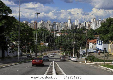 Sao Paulo, Brazil - Feb 08, 2020 - Cars Traffic In Avenue With Skyline Of Sao Paulo City With Blue S