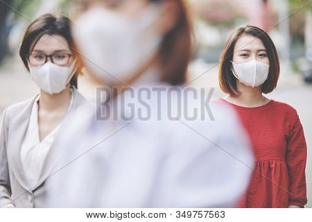 Asian People Wearing Medical Masks During Coronavirus Epidemic Outbreak In The City