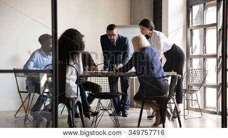 Multiethnic Staff Gathered At Boardroom Analyzing Data Brainstorming Share Thoughts