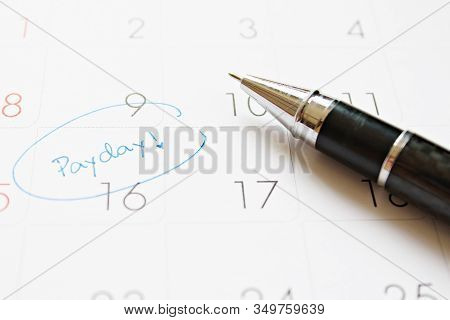 Business, Finance, Savings Money, Wages, Payroll Or Accounting Concept : Calendar With Blue Marker C