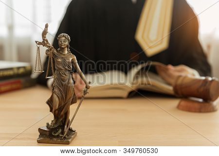 Statue Of Justice On Desk With Attorney Or Judge Studying Legal And Legislation. Concept Of Law, Leg