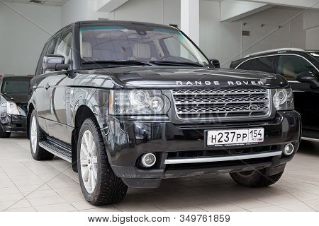 Novosibirsk, Russia - 02.07.2020: Black Used Land Rover Range Rover Supercharger 2010 With Front Vie