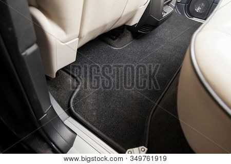 Clean Car Floor Mats Of Black Carpet Under Rear Passenger Seat In The Workshop For The Detailing Veh