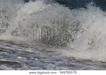 Close Up Of A Blue Clear Water Wave On Sea , Beach Background,peaceful Sea Wave At Beach. Sea Waves