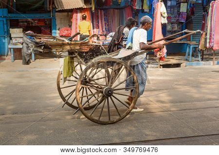 Kolkata, India - March 13, 2019: Man Rickshaw Puller Is Pulling His Hand Rickshaw On The Street