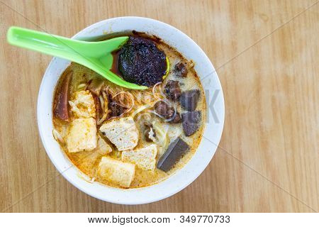 Overhead View Of Penang White Curry Mee Noodle With Solid Pig Blood And Cockerel