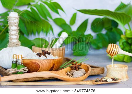 Tray With Set For Relaxing Spa Thai Treatments. Herbal Massage Pouch, Wooden Mortar Pounder With Her