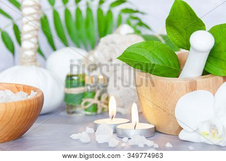 Closeup Wooden Mortar, Pounder With Herbs, Bowl With Salt, Small Bottles With Aromatic Oils, Herbal