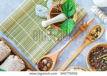 Top View Of Set For Relaxing Healing Thai Spa Treatments. Towel Rolls, Bowl And Spoons With Spices,