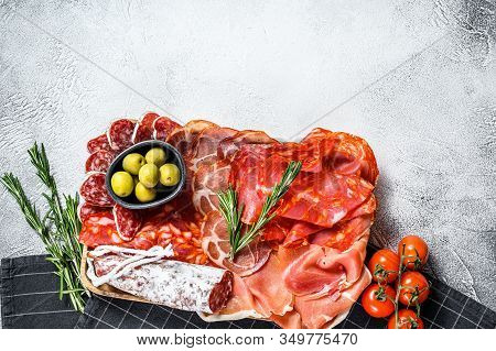 Cured Meat Platter Of Traditional Spanish Tapas. Chorizo, Jamon Serrano, Lomo And Fuet. Gray Backgro