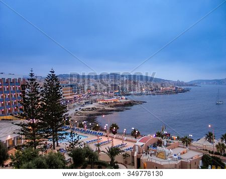 Bugibba, Malta - June 13, 2005: Aerial View Of Maltese Town Seafront And Its Bay Area In Bugibba, Ma
