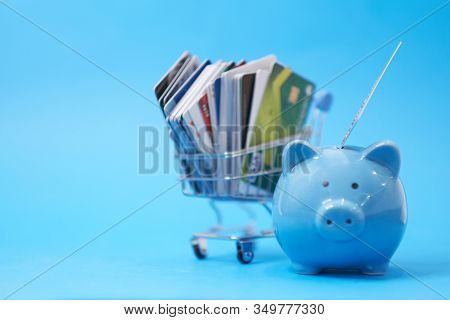 Piggy Bank And Pile Of Credit Cards , Financial Waste. Debt Restructuring, Financial Distress, Reneg