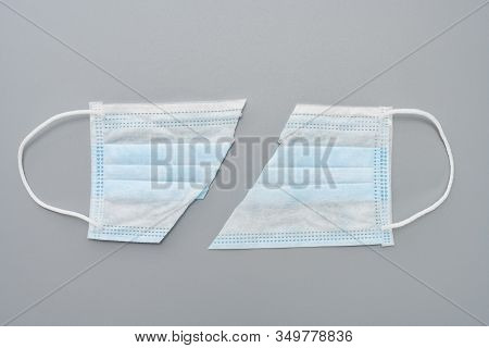 Cut Out Medical Face Mask On Grey Background Concept Of Fake Or Useless Or Invalid Mask