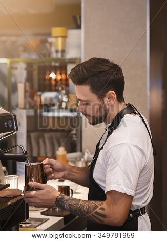 Coffee-shop Concept. Professional Barista Making Coffee Using Coffee-machine Standing In Cafe. Small